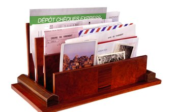 Postcards stand out in a pile of mail and are read before letters are opened.