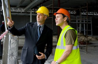 A construction company owner supervises work on-site.
