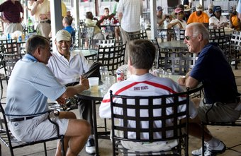 President Obama and House Speaker Boehner relax after a round of golf.