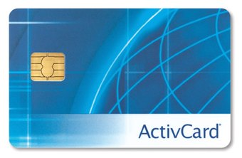 Military ID card administrators encode active duty cards with personal information.