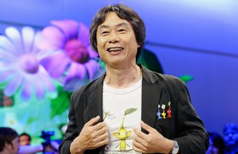 Game designers such as Nintendo's Shigeru Miyamoto show off their wares at the annual E3 convention.