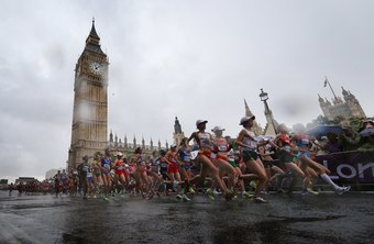 Wear moisture-wicking fabrics and a hat to run a marathon in the rain