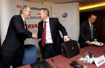 Executives from American Airlines, British Airways and Iberia announced a joint venture.