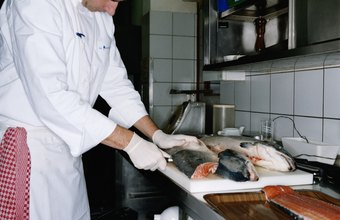 Fish filleters cut whole fish into fillets.