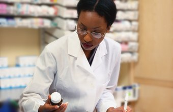 Hospital pharmacists dispense medications for each day's patients.