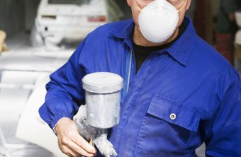 Automotive painters use pressurized spray guns to apply paint.