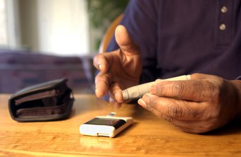 People with diabetes use a blood glucose monitor to check blood sugar levels.