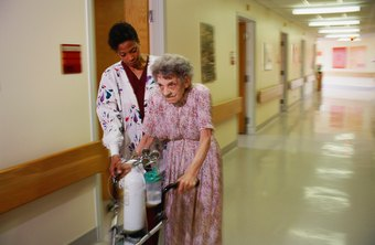 Nurse's aides help patients move about.