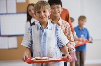 School food service assistants provide healthful meals to children.