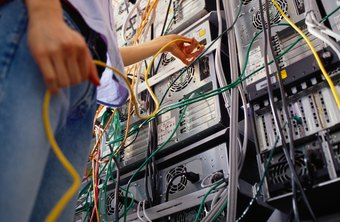 A network engineer connecting computer and network systems.