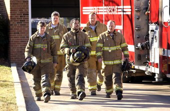 Firefighters preparing to leave for a fire emergency.