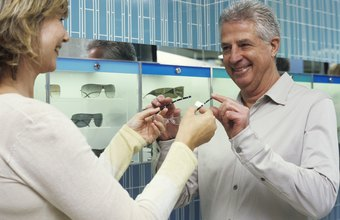 Optical assistants help customers choose eyeglass frames.