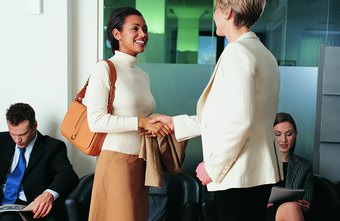 A firm handshake and direct eye contact are part of good business etiquette.