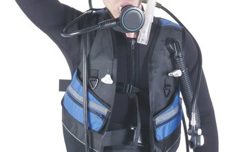 A Navy Medical Deep Sea Diving Technician is trained to dive with full diving gear.