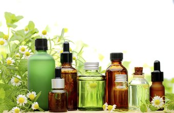 Small bottles of oils with flowers in the background