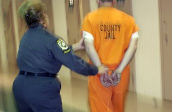 A correctional officer escorts an inmate.