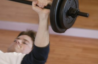 Hold the weight in place to perform isometric bench presses.