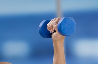 A dumbbell can help you graduate to a kettlebell in the Turkish get-up.