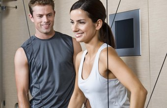 Fitness coaches teach people to use exercise equipment properly.