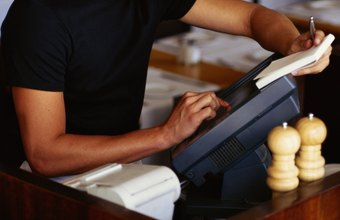 Cash-handling workers add up payments.