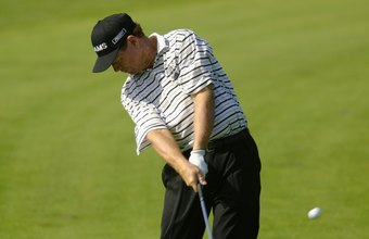 Hall of Famer Tom Watson takes a divot at the bottom of his downswing arc.