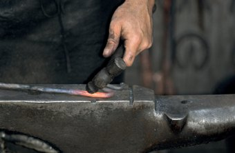 Blacksmiths forge and repair metal objects, such as tools.