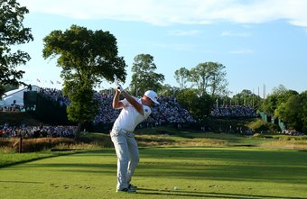 Tour pros like Hunter Mahan use torso rotation to pull their left arms in the downswing.
