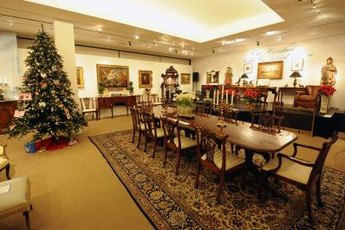 Real estate auctions occasionally include the sale of the owner's personal possessions.