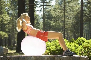 Crunches on a stability ball can help tighten your tummy.