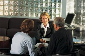 An insurance adjuster discusses compensation options with claimants.
