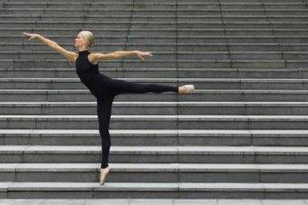 Improve your arabesque with a yoga stretch.