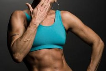 Women can build significant muscle through high-volume workouts.