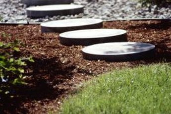 Mix pavestones with multiple materials for a low-cost pathway.