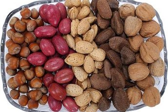 Walnuts, pecans and pistachios contain healthy fats that may help lower your cholesterol.