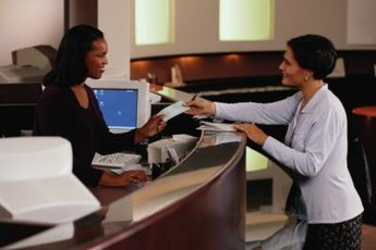 Bank tellers assist customers with transactions.