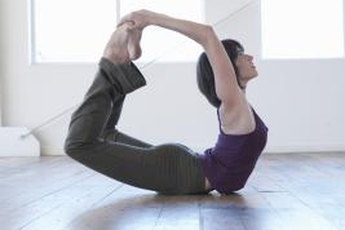 Bow pose can help tighten the stomach.