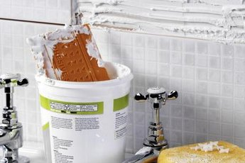 Adding tile can update your bathroom on a budget.