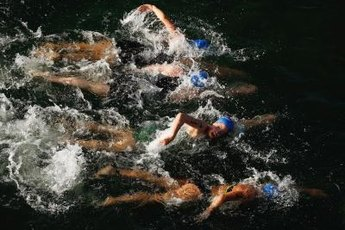 Triathletes often use crossover kicking to keep their legs fresh for the biking and running legs of the race.