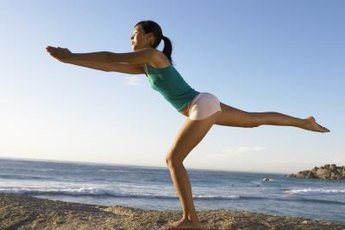 Standing balance exercises target your abs and legs simultaneously.