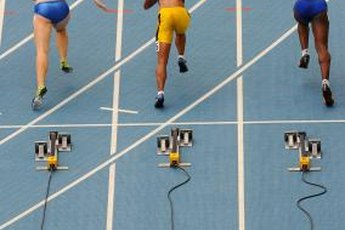 Female sprinters burst out of the blocks and enter the drive phase.