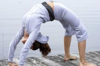 Urdhva Dhanurasana stretches the entire front of your body.