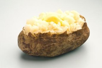 Butter adds a significant amount of fat to a baked potato.