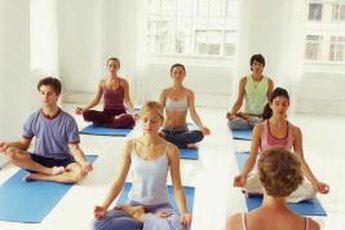 Women benefit from stress relief in yoga class.