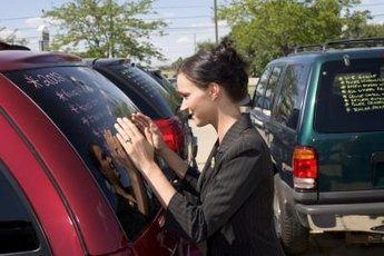 Sign on the dotted line to transfer the title of your car to a new owner.