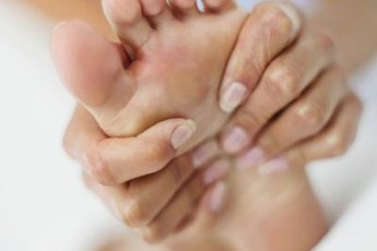 Inflammation in the metatarsal area causes pain in the ball of the foot.