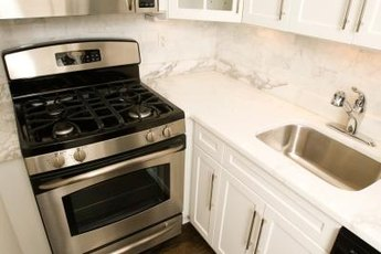 Secondhand appliances in good condition save money on the kitchen makeover.