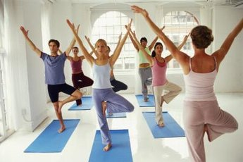 A yoga class promotes team building.