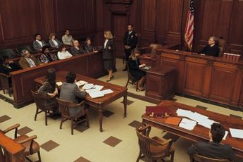 Criminal defense attorneys defend clients in a criminal trial.