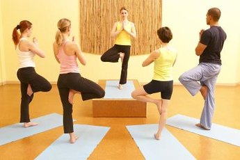 You can practice yoga individually or in a group class.