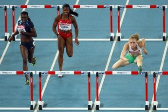 Sally Pearson of Australia throws her lead leg over the hurdle on her way to London Olympic gold.